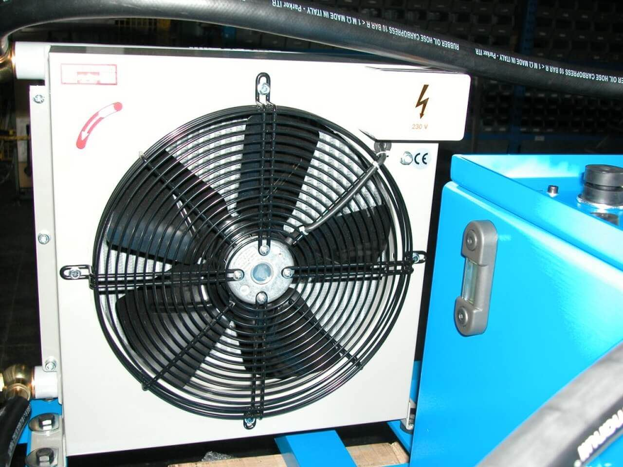 High speed package and heat exchanger for guillotine shears ...