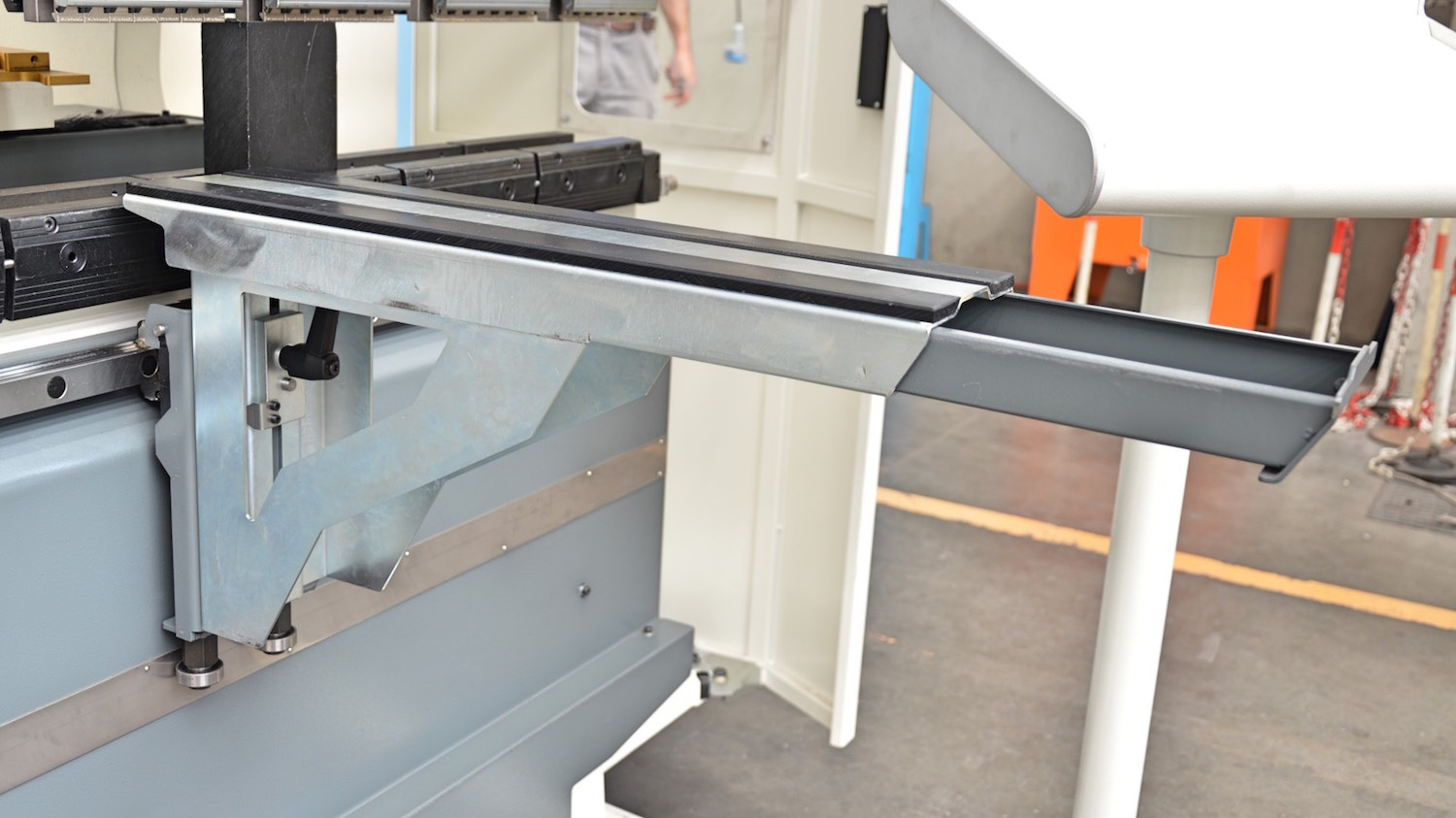 sliding front support arms with tool drawer